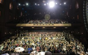 Tony Levin photographs the audience at the Fox Theater
